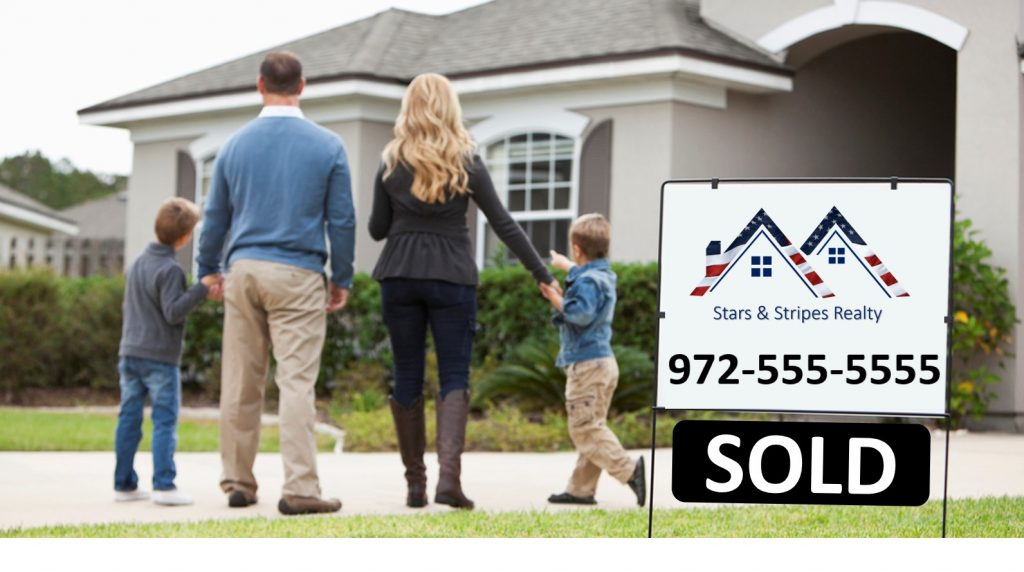 family standing in front of home with sold sign